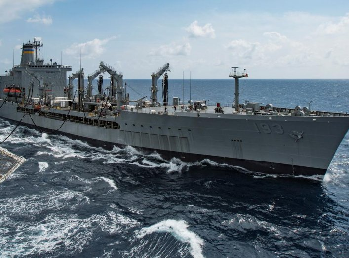 Military Sealift Command fleet replenishment oiler USNS Walter S. Diehl (T-AO 193) pulls alongside hospital ship USNS Mercy (T-AH 19) to deliver supplies and mail by a connected replenishment in the South China Sea August 15, 2016. Picture taken August 15
